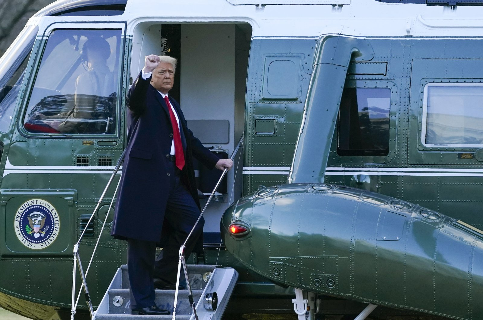 President Donald Trump gestures as he boards Marine One on the South Lawn of the White House, in Washington D.C. on Jan. 20, 2021. (AP Photo)
