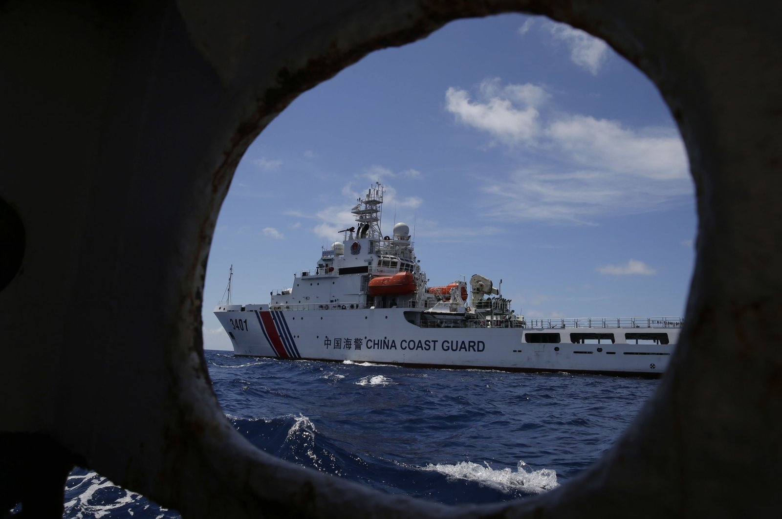 A Chinese Coast Guard ship attempts to block a Philippine government vessel as the latter tries to enter Second Thomas Shoal to relieve Philippine troops and resupply provisions, March 29, 2014. (AP Photo)