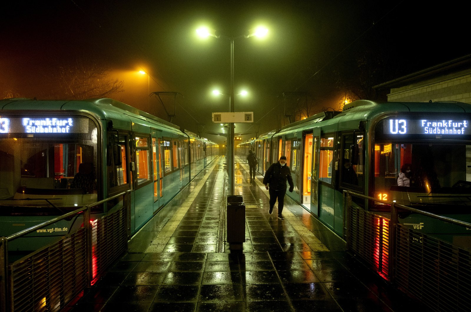 A woman walks away from a subway station during the coronavirus pandemic in Oberursel near Frankfurt, Germany, Nov. 12, 2020. (AP Photo)
