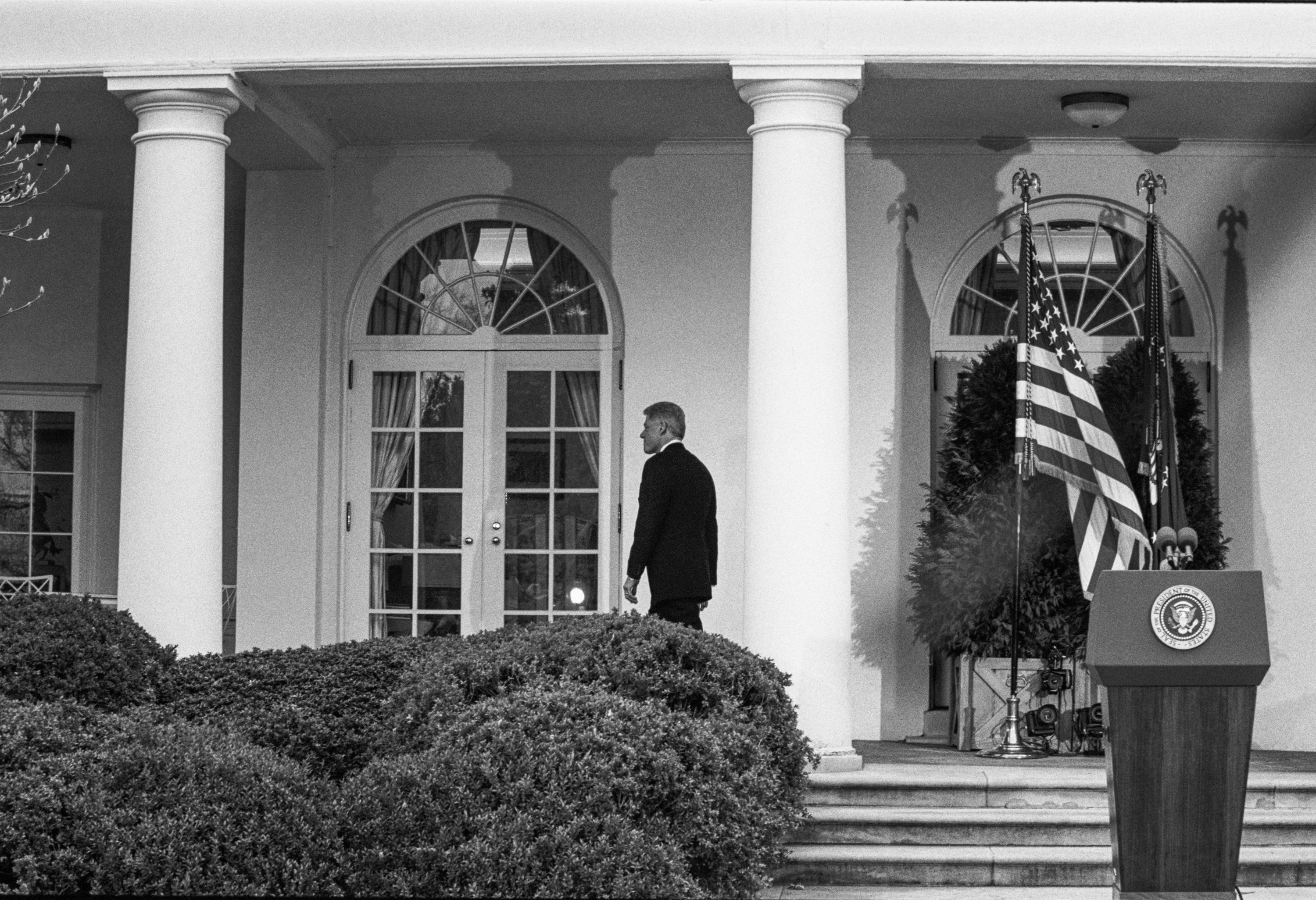 Then-U.S. President Bill Clinton returns to the Oval Office after learning that the U.S. Senate voted to acquit him of the charges of perjury and obstruction of justice during his impeachment trial, Washington, D.C., the U.S., Feb. 12, 1999. (Photo by Getty Images)
