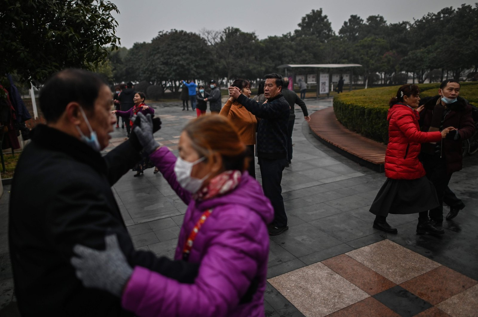 People dance in a park in Wuhan, China, Jan. 23, 2021. (AFP Photo)