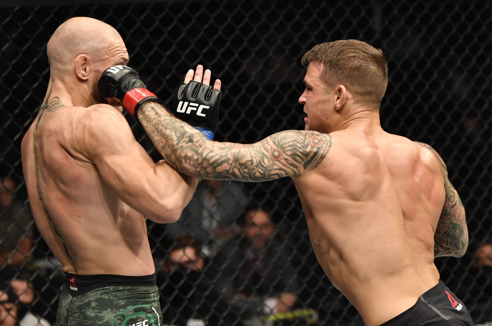 Dustin Poirier punches Conor McGregor in a lightweight fight during the UFC 257 event inside Etihad Arena on UFC Fight Island, Abu Dhabi, UAE, Jan. 23, 2021. (Reuters Photo)