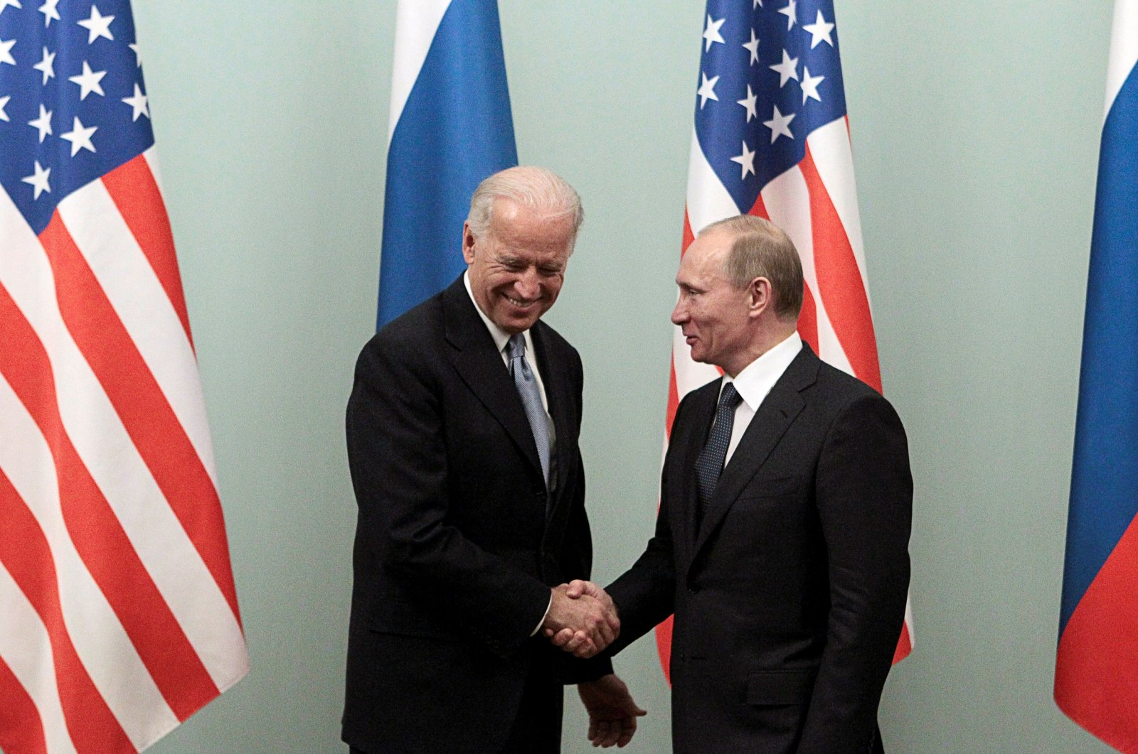 Russian Prime Minister Vladimir Putin (R) shakes hands with then-U.S. Vice President Joe Biden during their meeting in Moscow on March 10, 2011. (Reuters Photo)