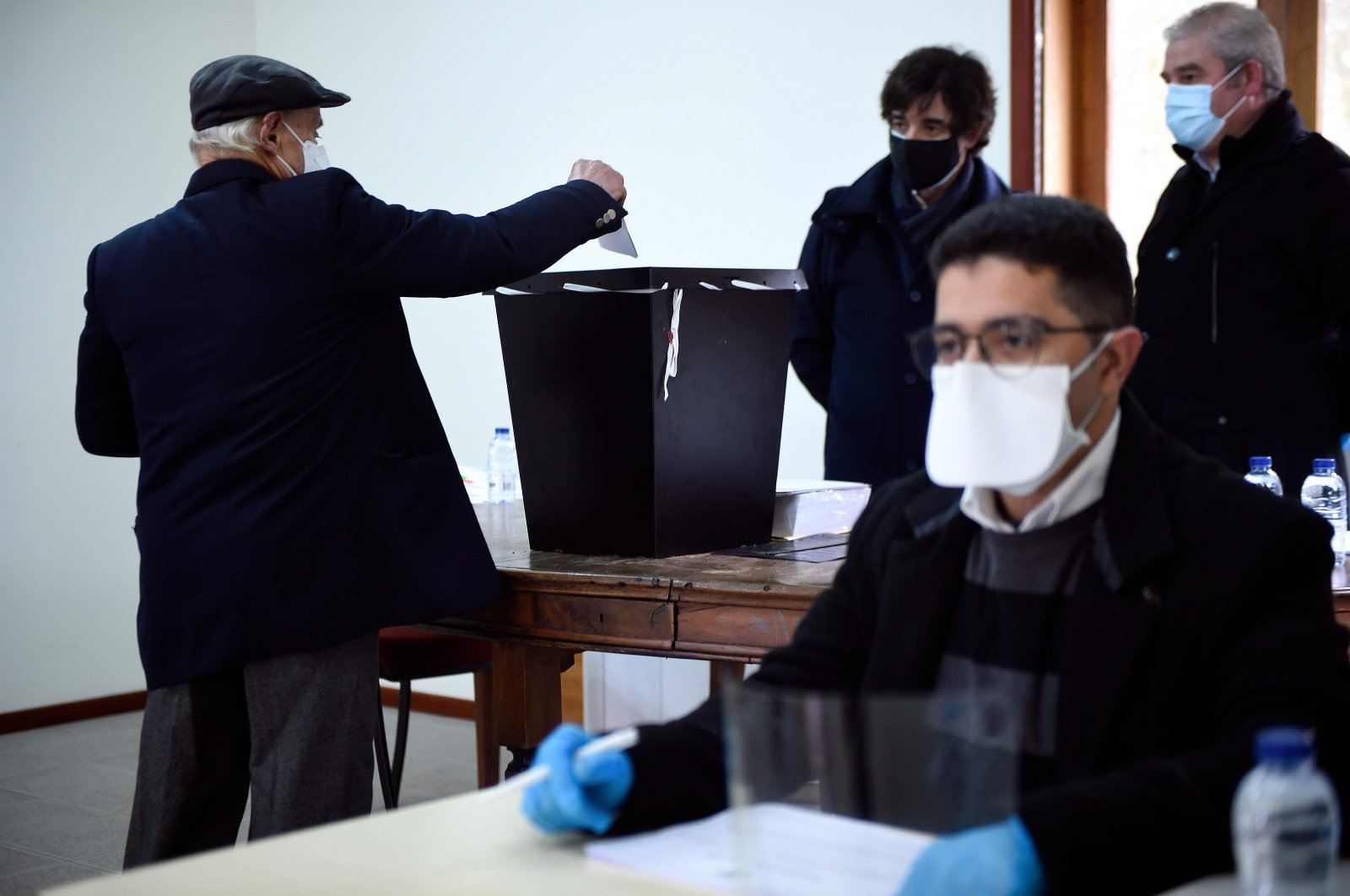 A man casts his ballot for the Portuguese presidential election at a polling station in Celorico de Basto on Jan. 24, 2021. (AFP Photo)