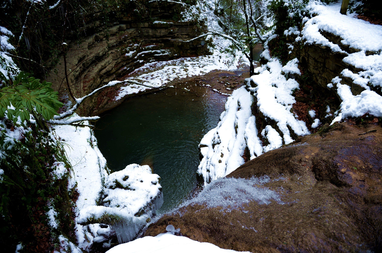 A waterfall flows down a hill, creating a small pond, at Erfelek Tatlıca Waterfalls Natural Park, in Sinop, northern Turkey, Jan. 22, 2021. (AA Photo)