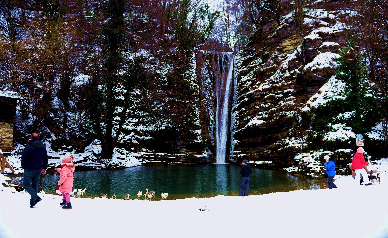 Children and their parents enjoy the view of a waterfall at Erfelek Tatlıca Waterfalls Natural Park in Sinop, northern Turkey, Jan. 22, 2021. (AA Photo)
