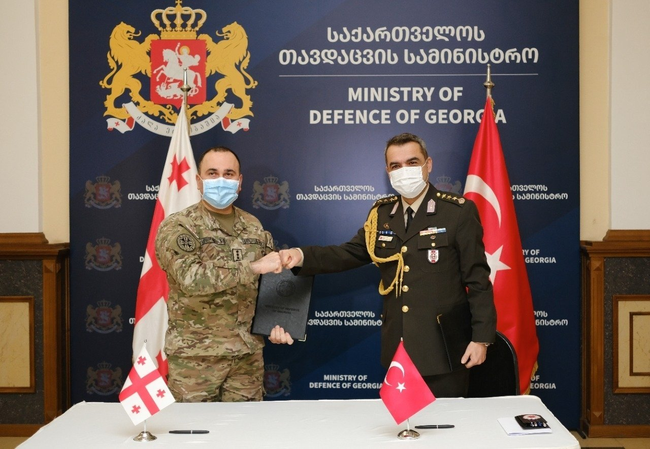 Head of Georgia's Strategic Planning Department Gen. Staff. Ioseb Nikoleishvili (L) and Turkey's military attache to the embassy in Tbilisi, Colonel Burak Altuner, sign a delivery record at the Georgian Defense Ministry, Jan. 24, 2021. (AA Photo)