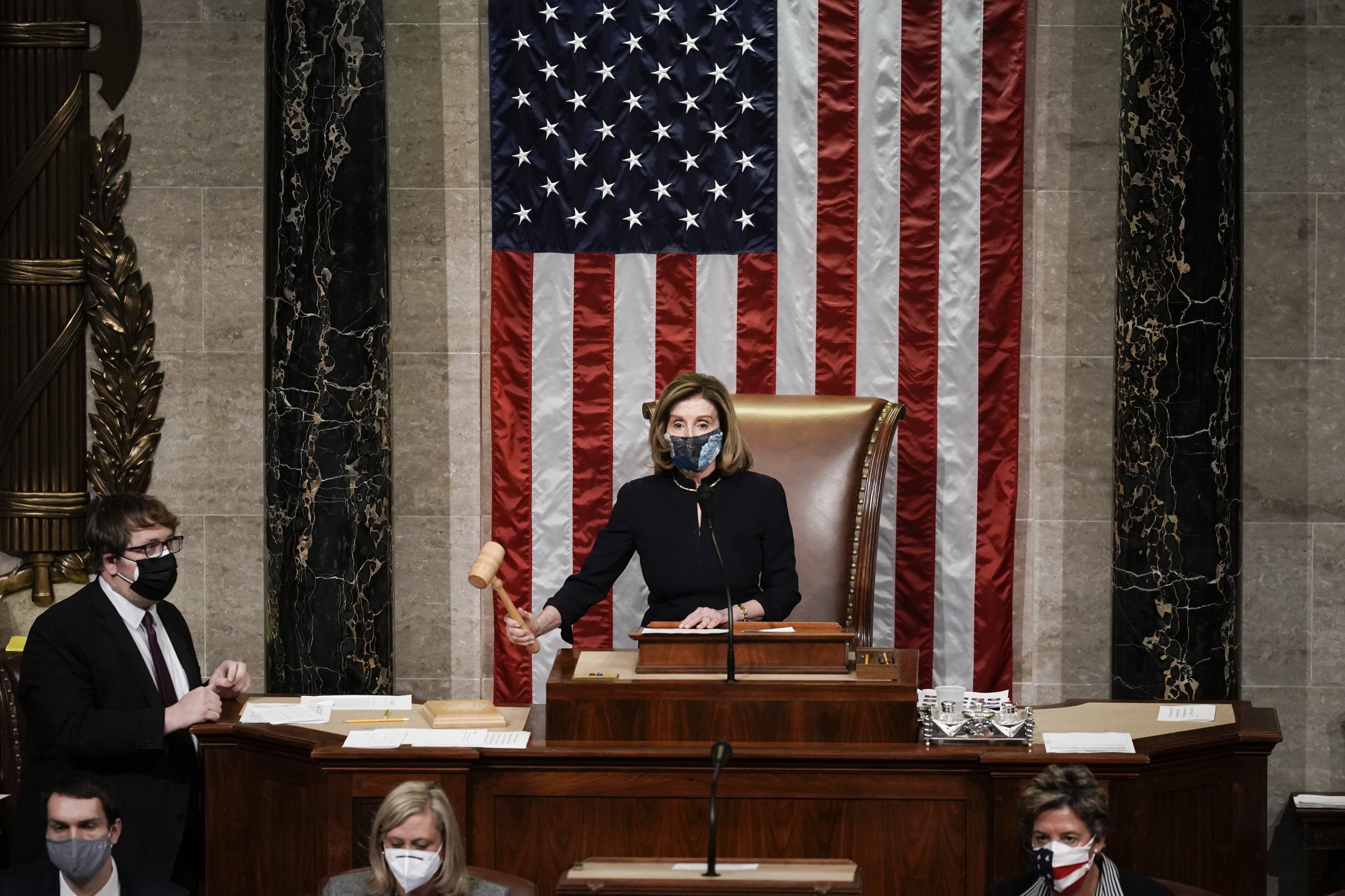 U.S. Speaker of the House Nancy Pelosi gavels in the final vote of the impeachment of U.S. President Donald Trump, for his role in inciting an angry storming into the U.S. Congress, Washington, D.C., Jan. 13, 2021. (AP Photo)