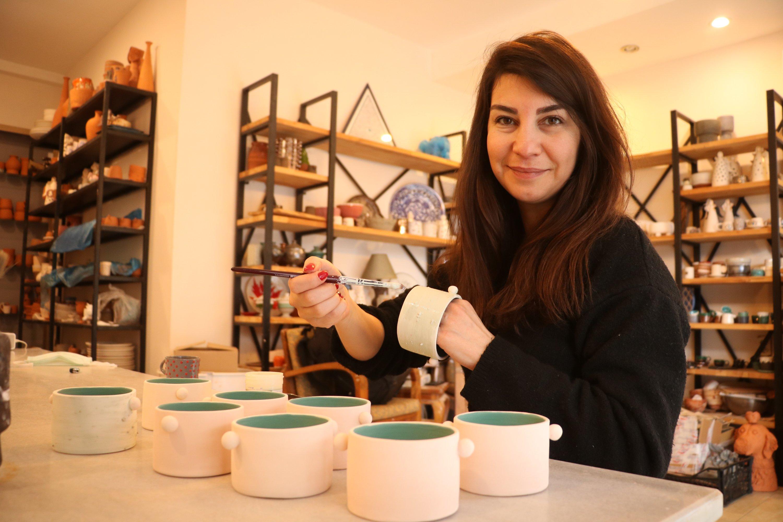 Seda Görgün, a local workshop owner, works on pottery pieces, in Çanakkale, northwestern Turkey, Jan. 23, 2021. (AA Photo)