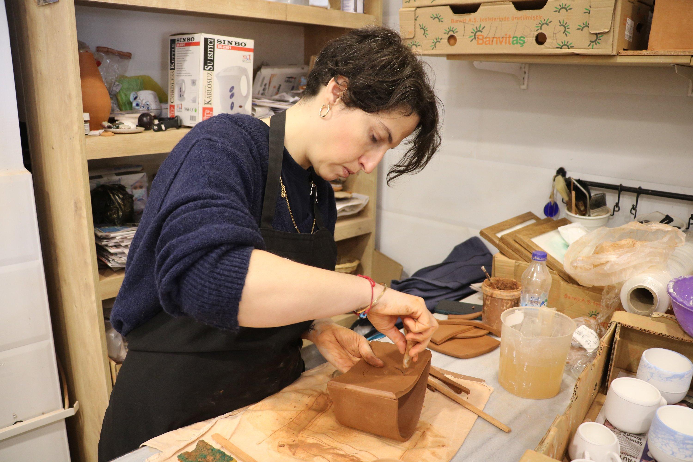 Elif Çetin, a local potter, works on a piece at her workshop, in Çanakkale, northwestern Turkey, Jan. 23, 2021. (AA Photo)