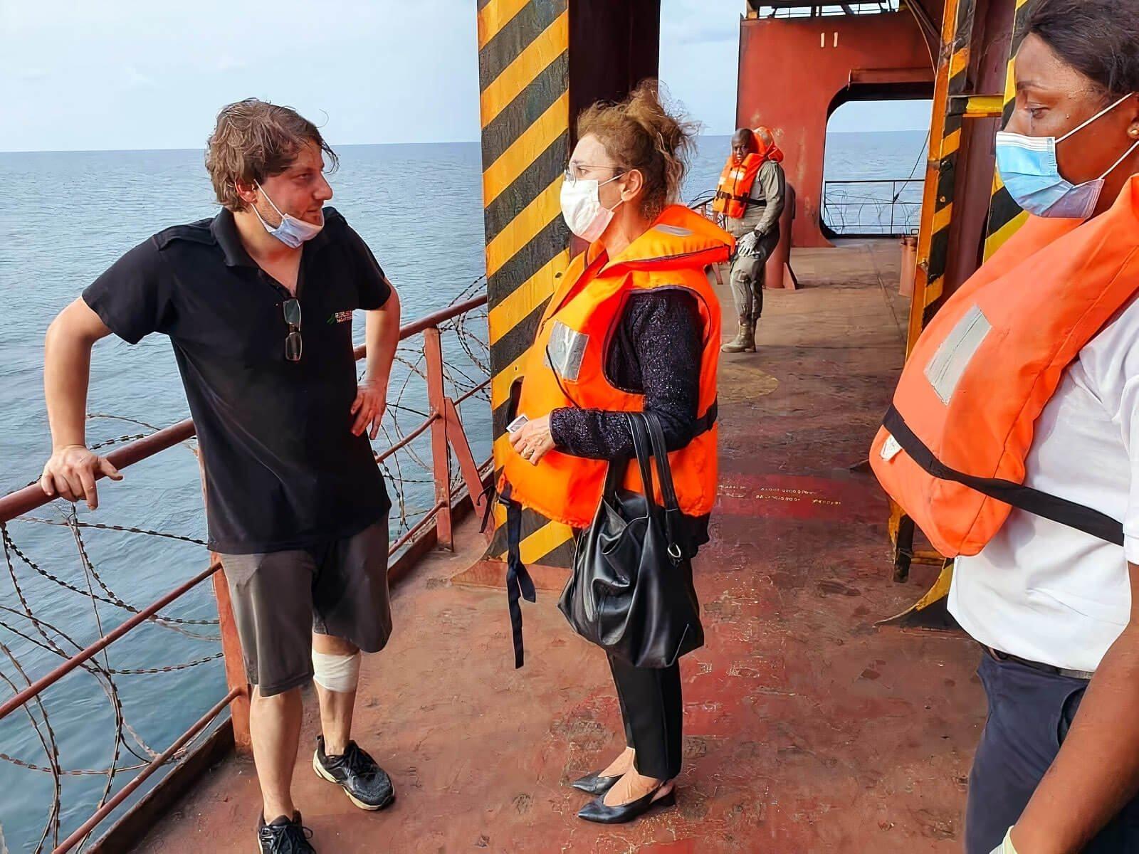 Senior officer Furkan Yaren (L), who escaped the pirates that attacked his ship, speaks to Turkey's Ambassador to Gabon Nilüfer Erdem Kaygısız (C) aboard the vessel in Port-Gentil, Gabon, Jan. 24, 2021. (AA PHOTO)