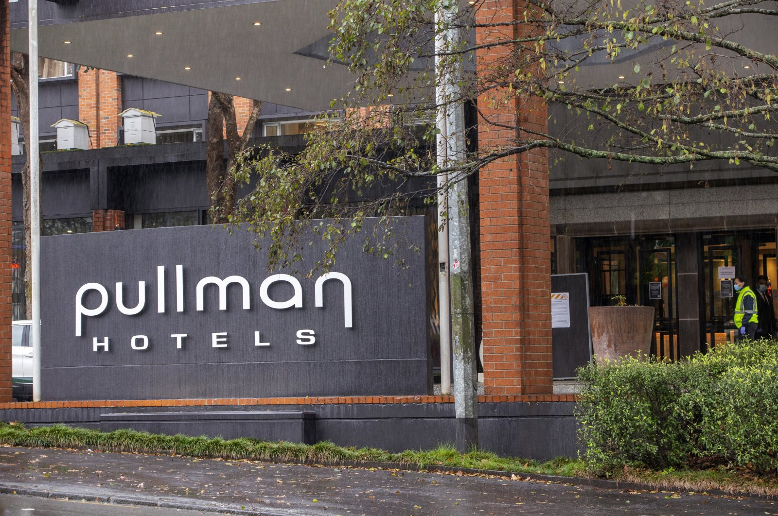 Security patrol outside the Pullman Hotel in Auckland, New Zealand, July 6, 2020. (AP Photo)