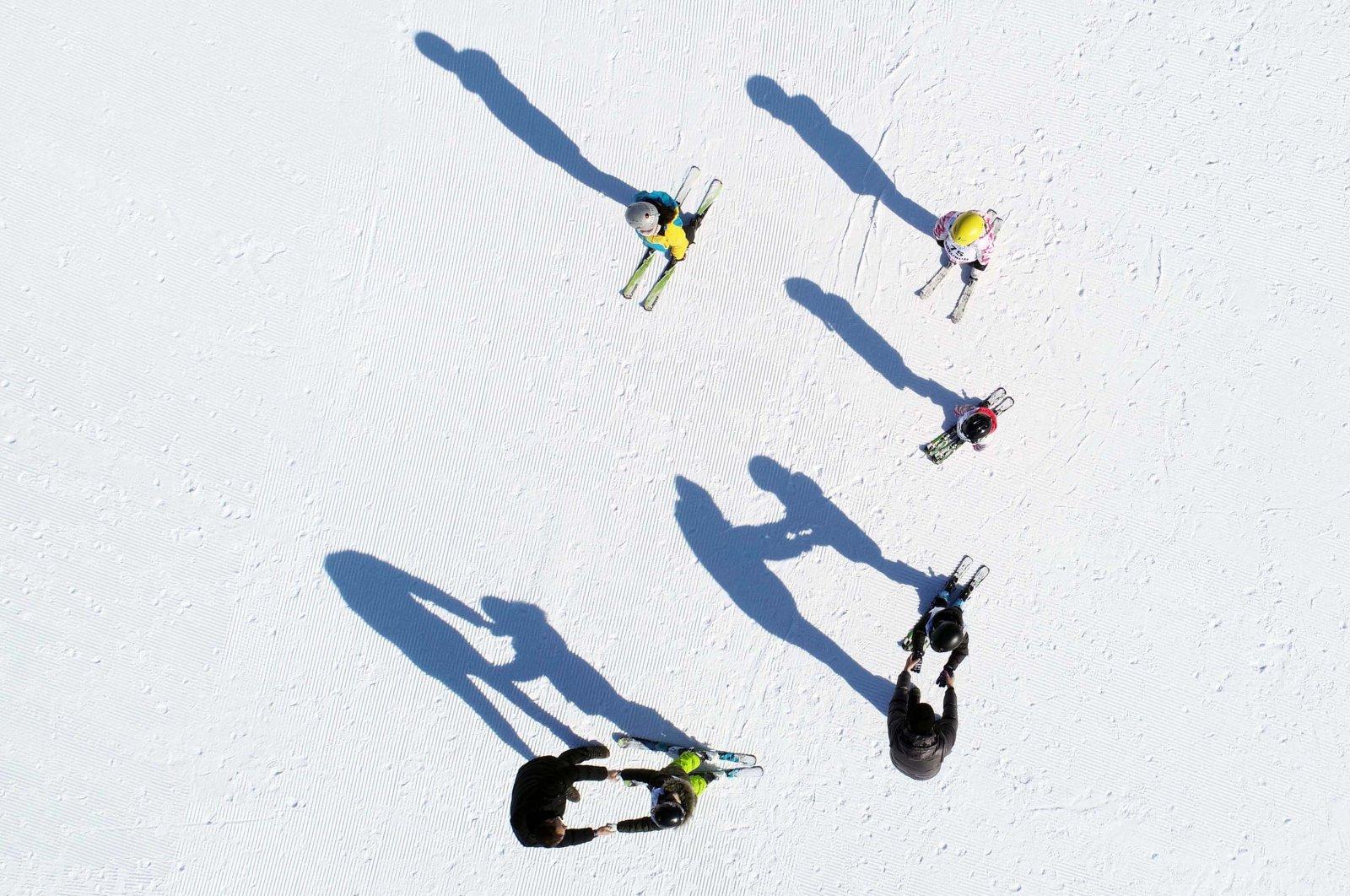 Kids receive skiing lessons from instructors at Palandöken Ski resort in Erzurum, eastern Turkey. (AA Photo)