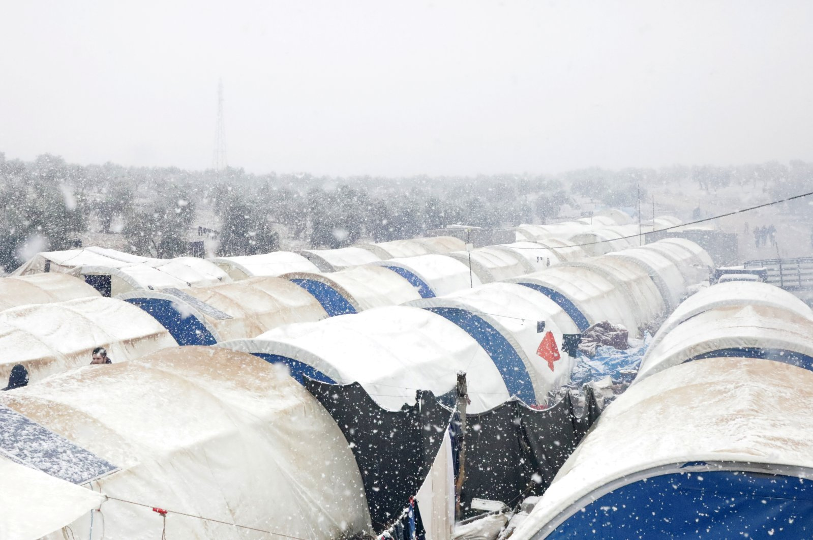 Tents partially covered with snow at a Syrian camp for the internally displaced in the northern Aleppo countryside, Syria, Jan. 20, 2021. (REUTERS Photo)