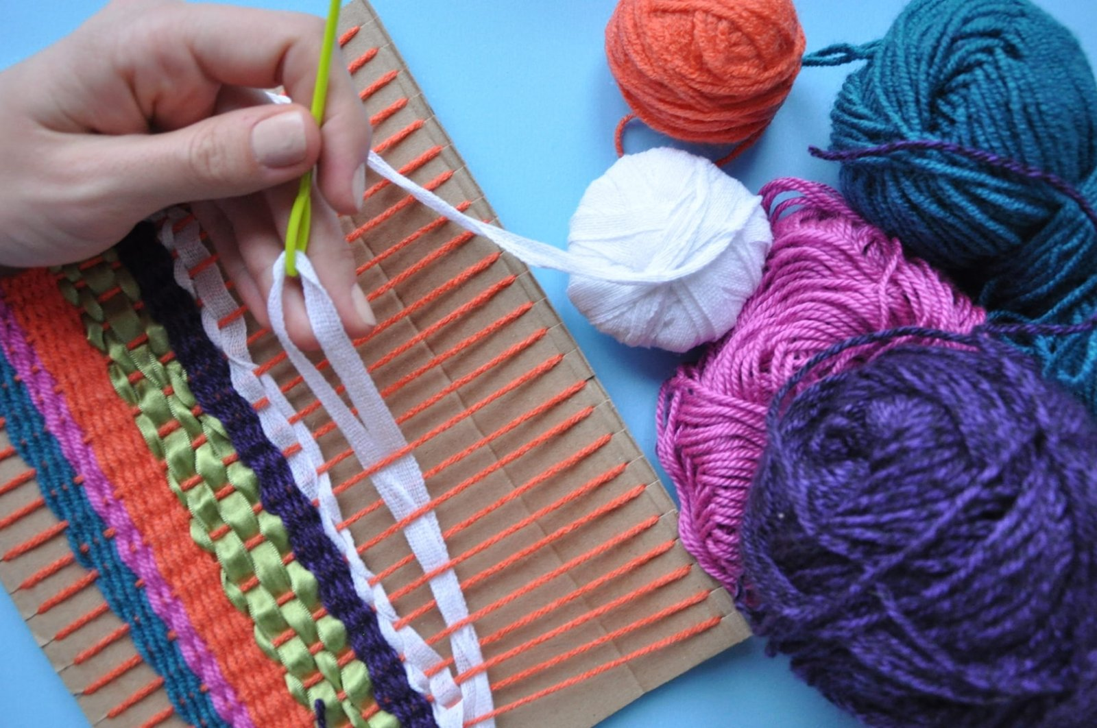 "Children will experience weaving as a tool of artistic expression in the workshop ""Weaving with Colorful Fabric."""