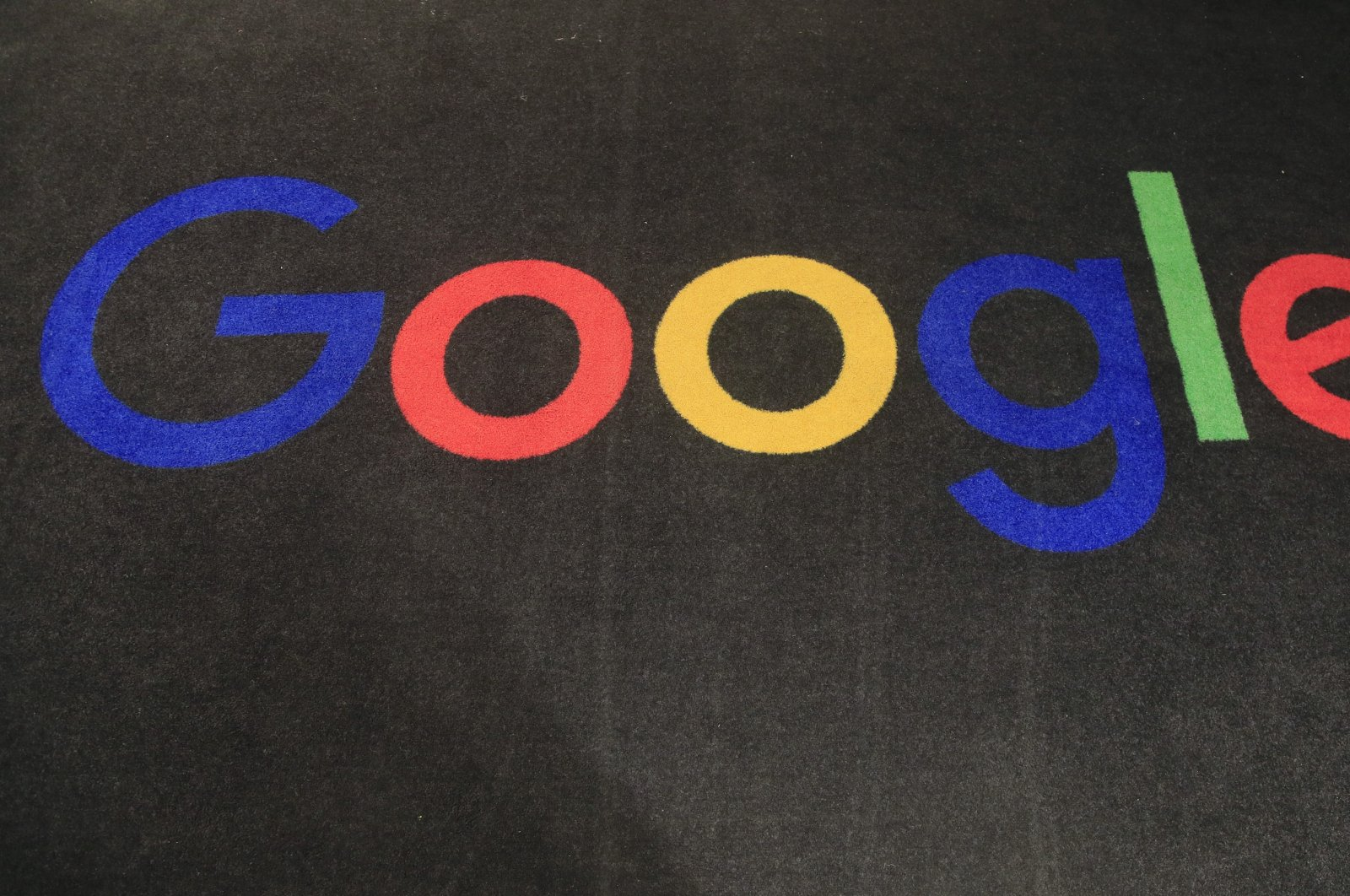 The logo of Google is displayed on a carpet at the entrance hall of Google France in Paris, France, Nov. 18, 2019. (AP Photo)
