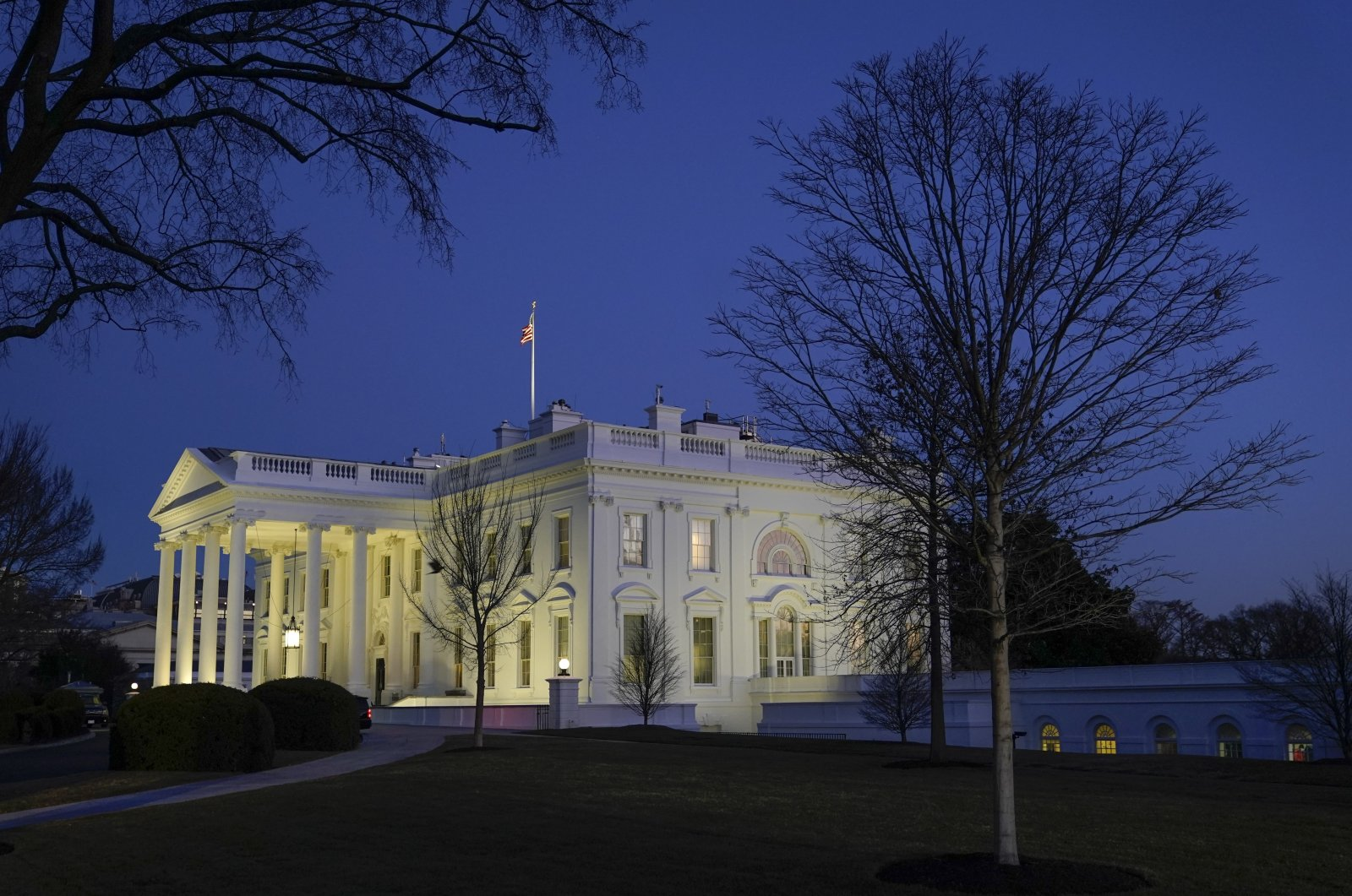 Dusk settles over the White House in Washington, D.C., U.S., Jan. 23, 2021. (AP Photo)