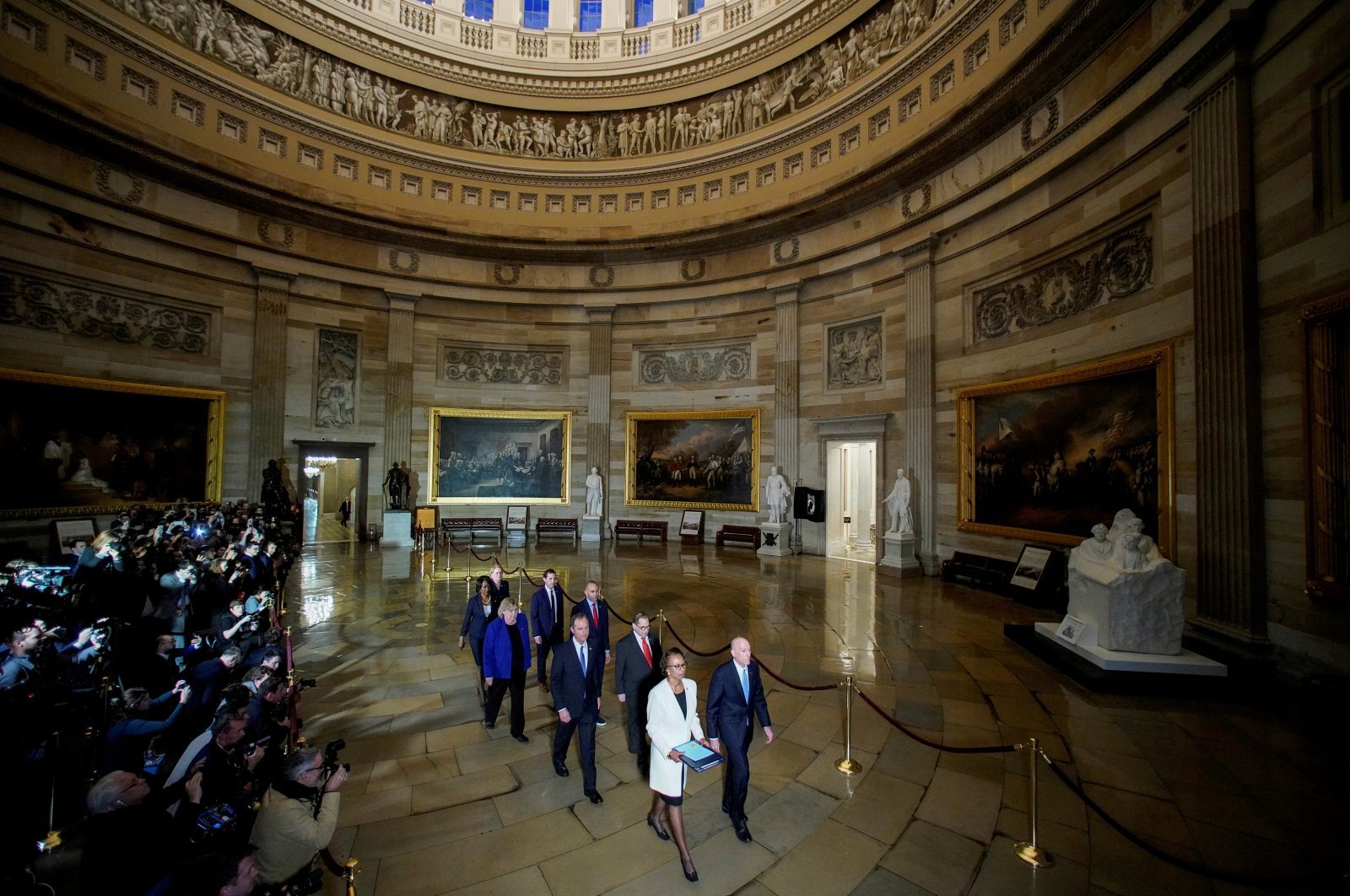 House Sergeant at Arms Paul Irving and House Clerk Cheryl Johnson carry two articles of impeachment against U.S. President Donald Trump during a procession with the seven House impeachment managers through the Rotunda of the U.S. Capitol to the U.S. Senate in Washington, U.S., Jan. 15, 2020. (Reuters Photo)
