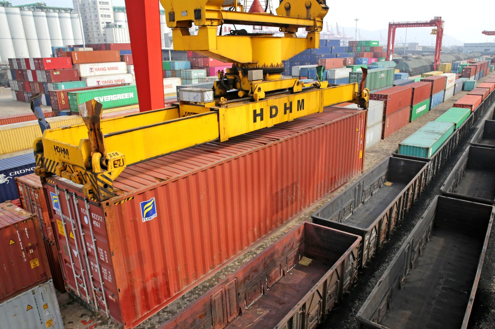 A worker controls the gantry crane to lift the export container at the station of Lianyungang logistics cooperation base of China and Kazakhstan, Lianyungang, Jiangsu Province, China, March 2, 2020. (Getty Images)