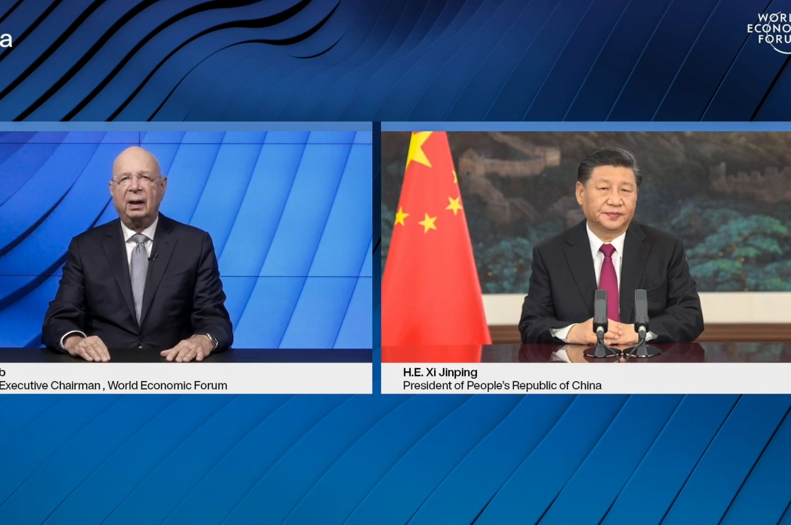 This video grab taken from the website of the World Economic Forum (WEF) shows WEF founder and executive chairman Klaus Schwab (L) speaking after China's President Xi Jinping (R) opened from Pekin an all-virtual gathering, which usually takes place in Davos, Switzerland, Jan. 25, 2021. (World Economic Forum via AFP)