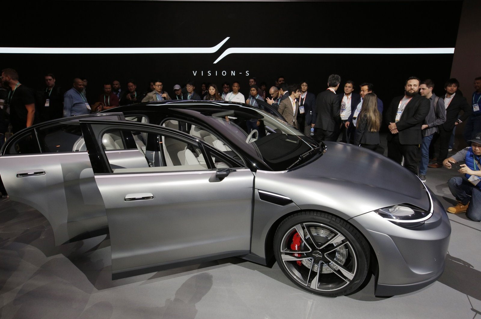People stand around the Sony Vision-S electric concept car at the Sony booth during the CES tech show, Las Vegas, U.S., Jan. 7, 2020. (AP Photo)