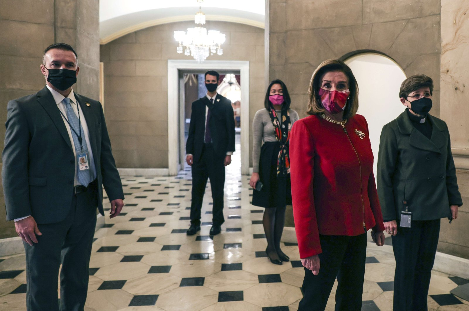 Speaker of the House Nancy Pelosi (D-CA) heads back to her office after calling the House of Representatives into a pro forma session in Washington, D.C., Jan. 25, 2021. (AFP Photo)