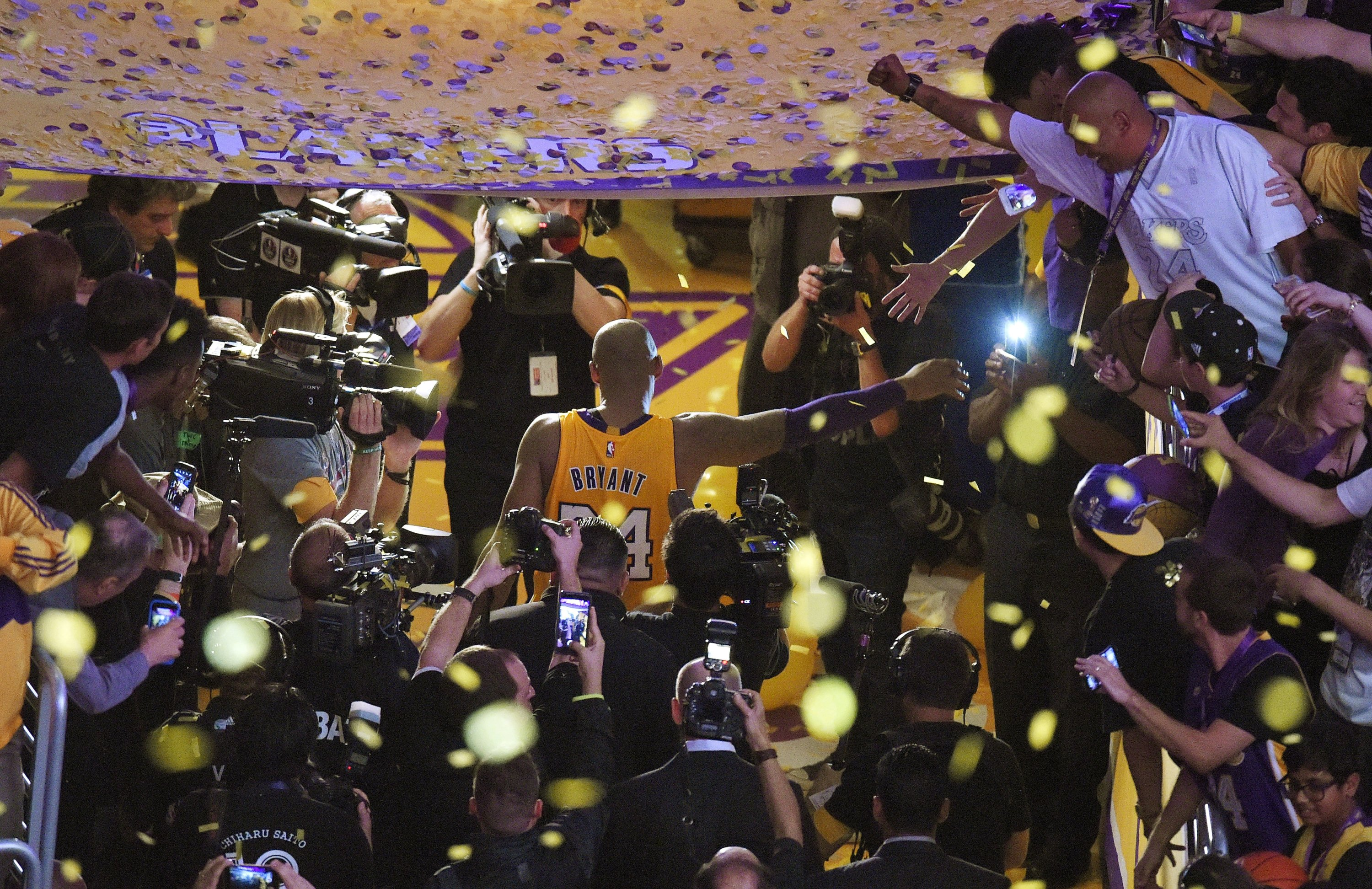 In this April 13, 2016, file photo, Los Angeles Lakers forward Kobe Bryant walks off the court after finishing his last NBA basketball game before retirement in Los Angeles. (AP Photo)