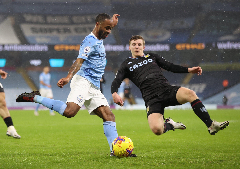 Manchester City's Raheem Sterling (L) in action against Aston Villa's Matt Targett during a English Premier League match in Manchester, England, Jan. 20, 2021. (EPA Photo)