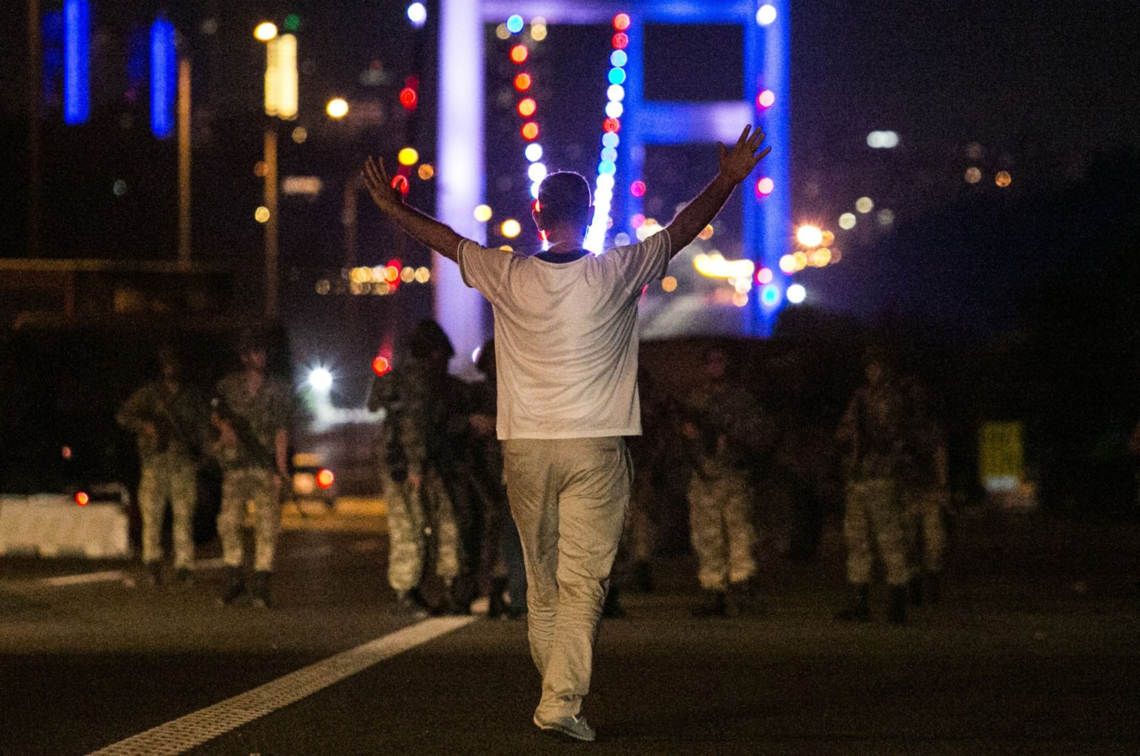 A man resists FETÖ-linked soldiers with his hands up at the entrance to the Bosphorus Bridge during the night of coup attempt, Istanbul, Turkey, July 16, 2016. (AFP Photo)