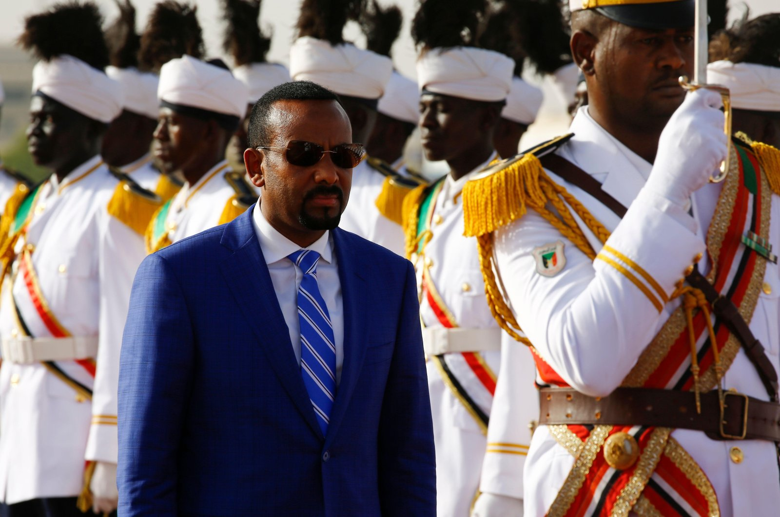 Ethiopian Prime Minister Abiy Ahmed reviews the honor guard following his arrival for an official visit, in Khartoum, Sudan, May 2, 2018. (AFP Photo)