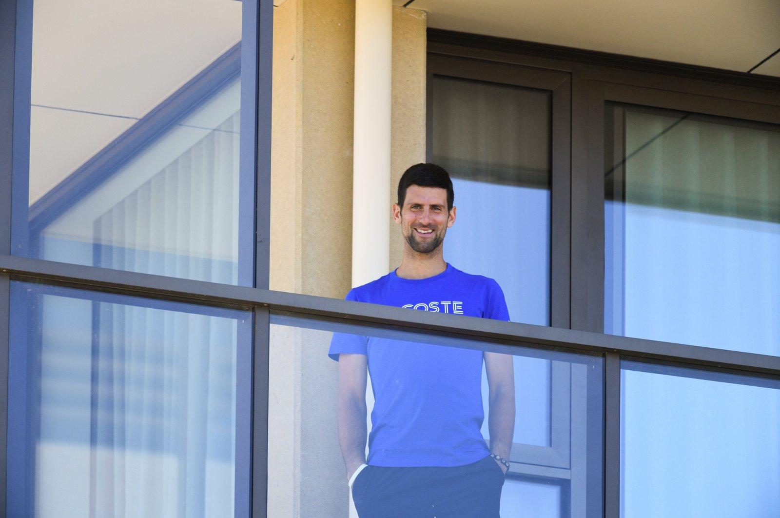 Novak Djokovic on the balcony of a hotel where tennis players are quarantining ahead of the Australian Open, Adelaide, Australia, Jan. 22, 2021. (REUTERS Photo)