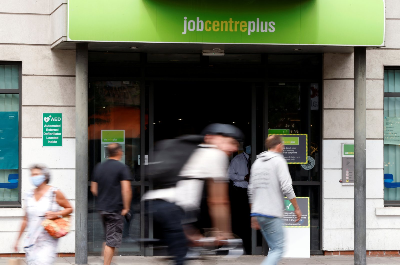 People walk past a branch of Jobcentre Plus, a government-run employment support and benefits agency, as the outbreak of the coronavirus disease (COVID-19) continues, in Hackney, London, Britain, Aug. 6, 2020. (Reuters Photo)