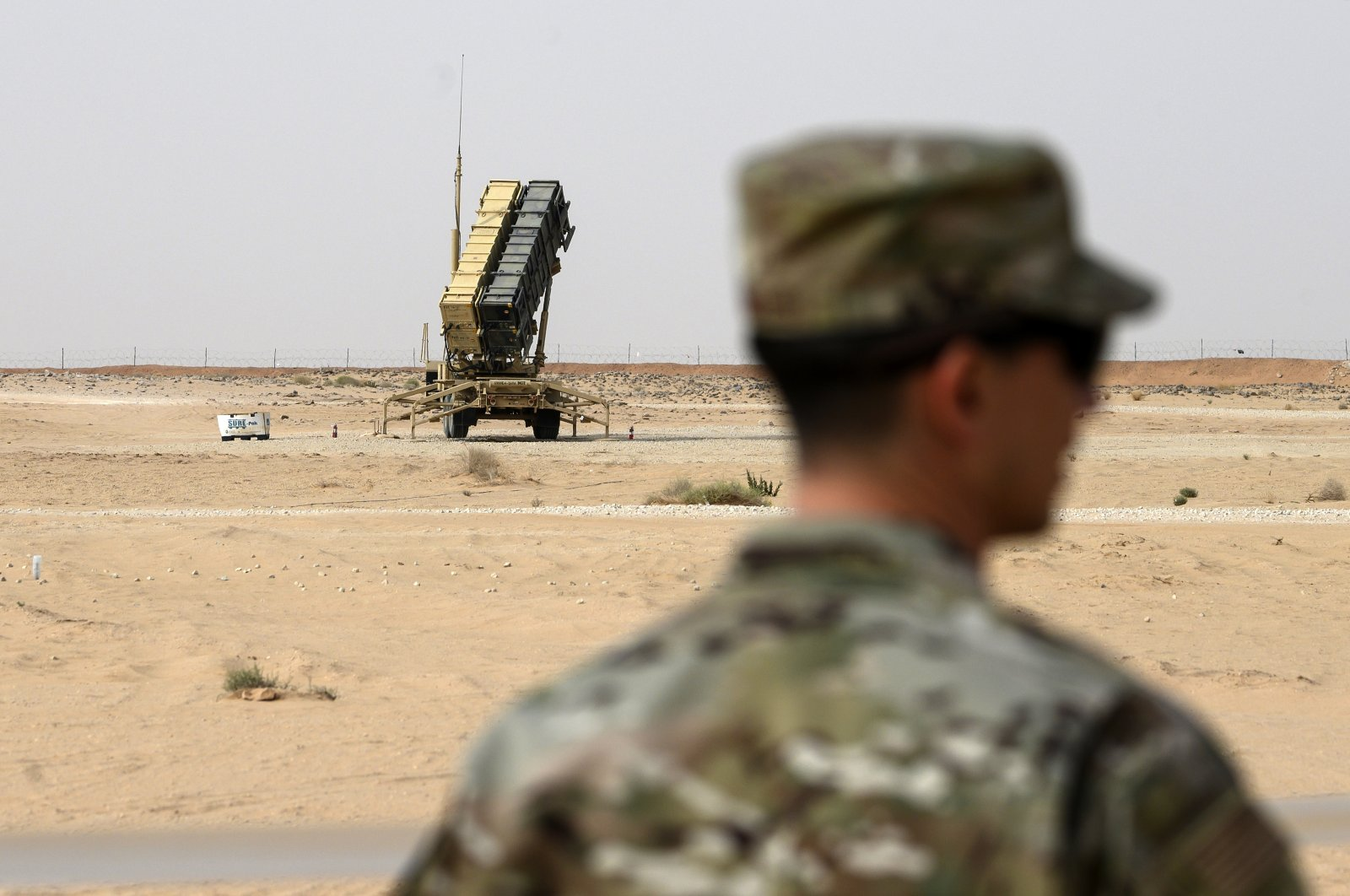 A member of the U.S. Air Force stands near a Patriot missile battery at the Prince Sultan Air Base in al-Kharj, Saudi Arabia, Feb. 20, 2020. (AP Photo)