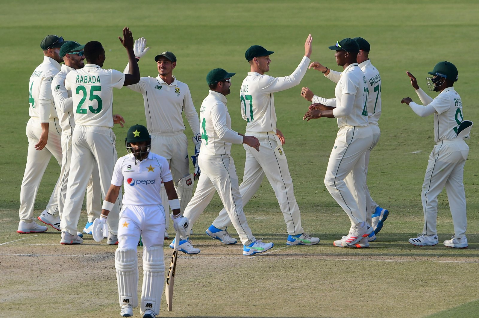 South African players celebrate the dismissal of Pakistan's Imran Butt (front) during the first day of the first Test at the National Stadium, Karachi, Pakistan, Jan. 26, 2021. (AFP Photo)