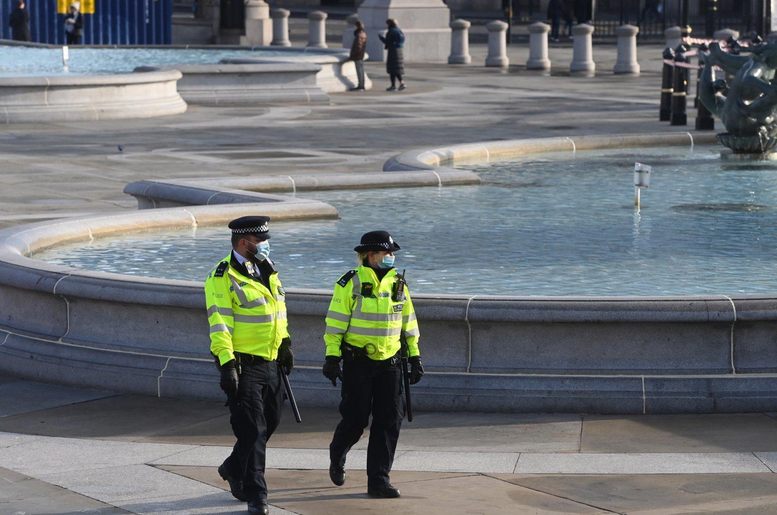 Police patrol Trafalgar square during the third national lockdown in London, Britain, Jan. 23, 2021. (EPA Photo)