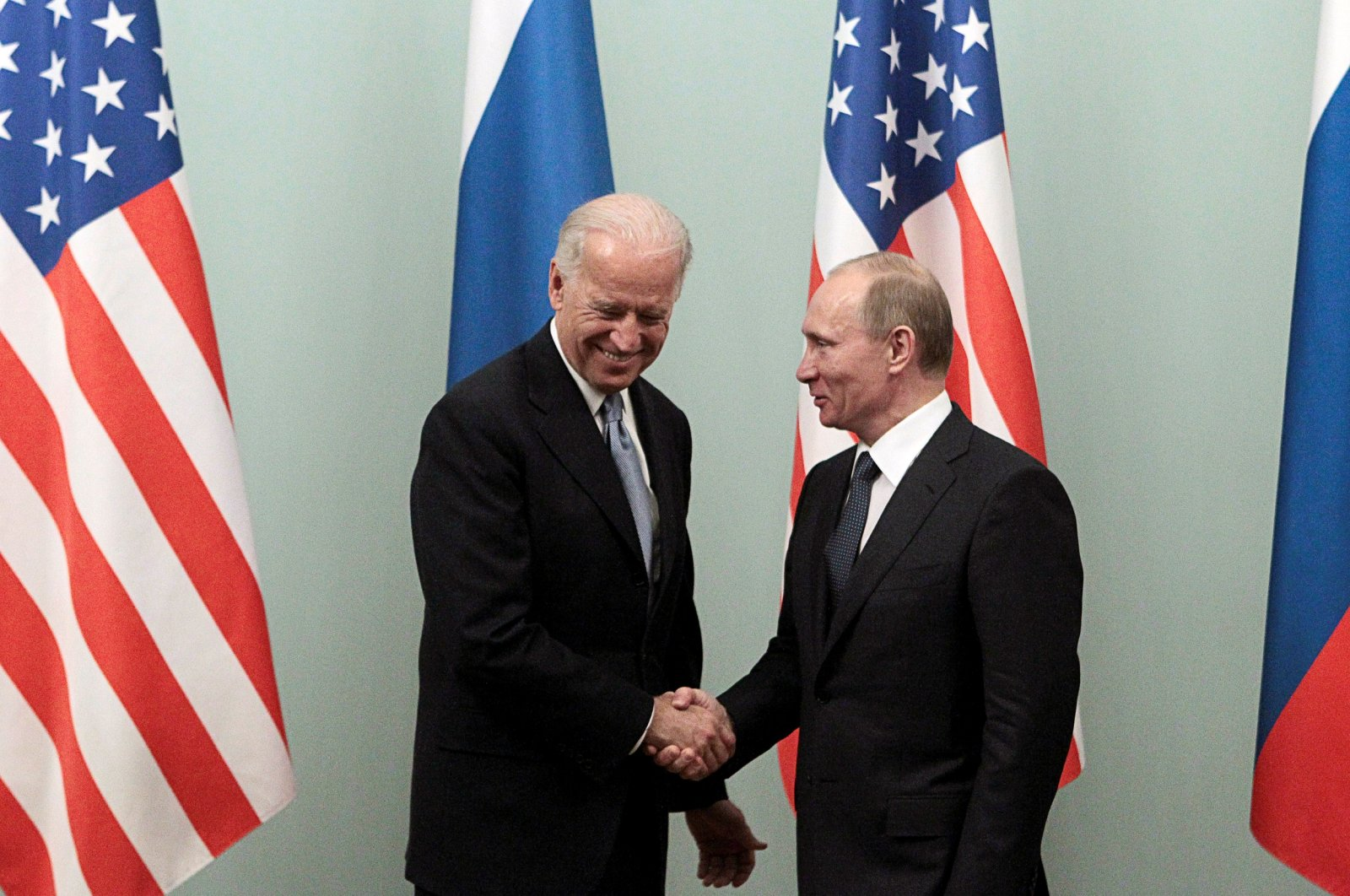 Russia's then-Prime Minister Vladimir Putin (R) shakes hands with U.S.' then-Vice President Joe Biden during their meeting in Moscow March 10, 2011. (Reuters File Photo)