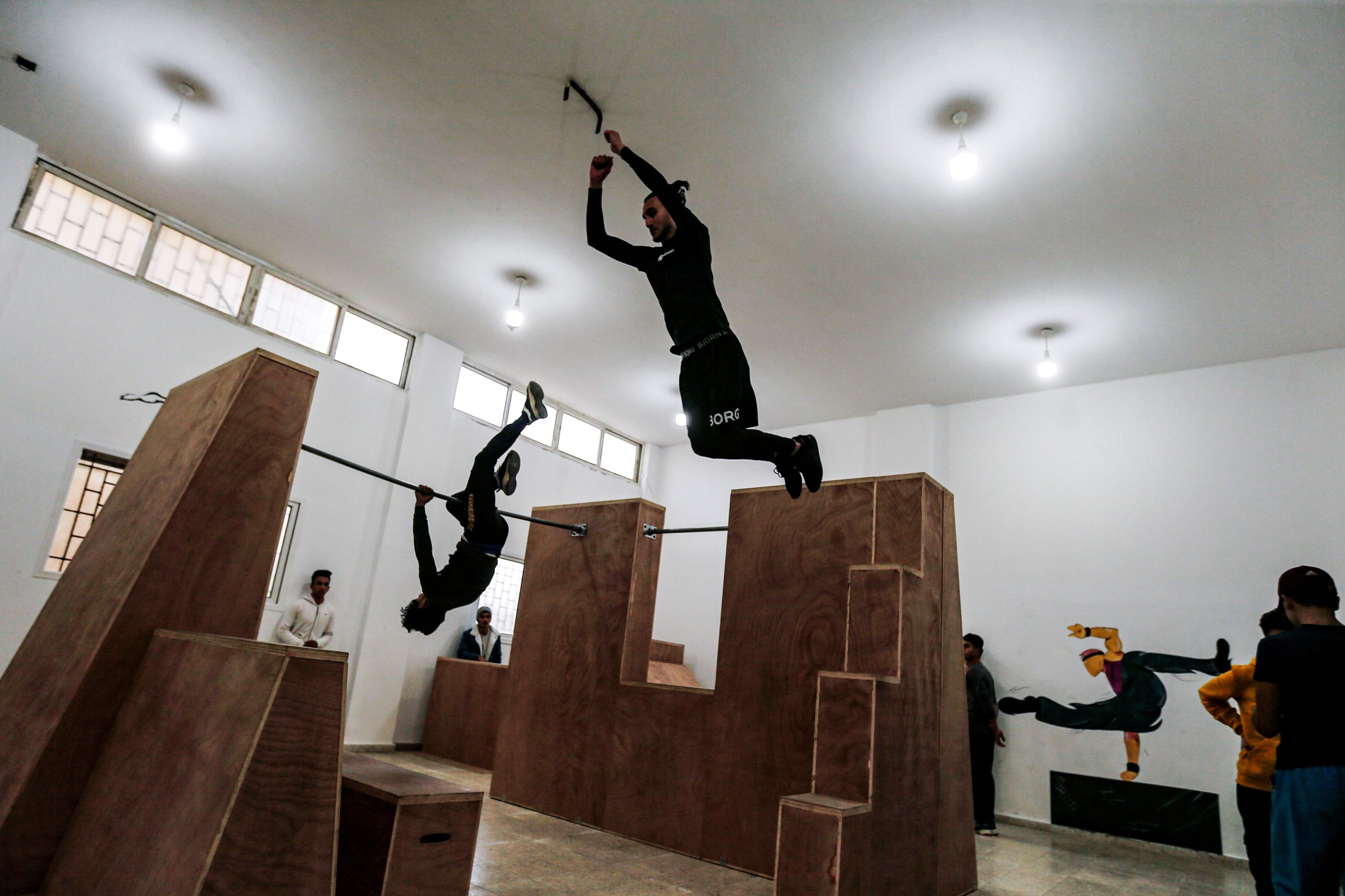 Palestinian youth train at the Wallrunners Parkour Academy's training facility in Gaza City, Dec. 28, 2020. (AFP Photo)
