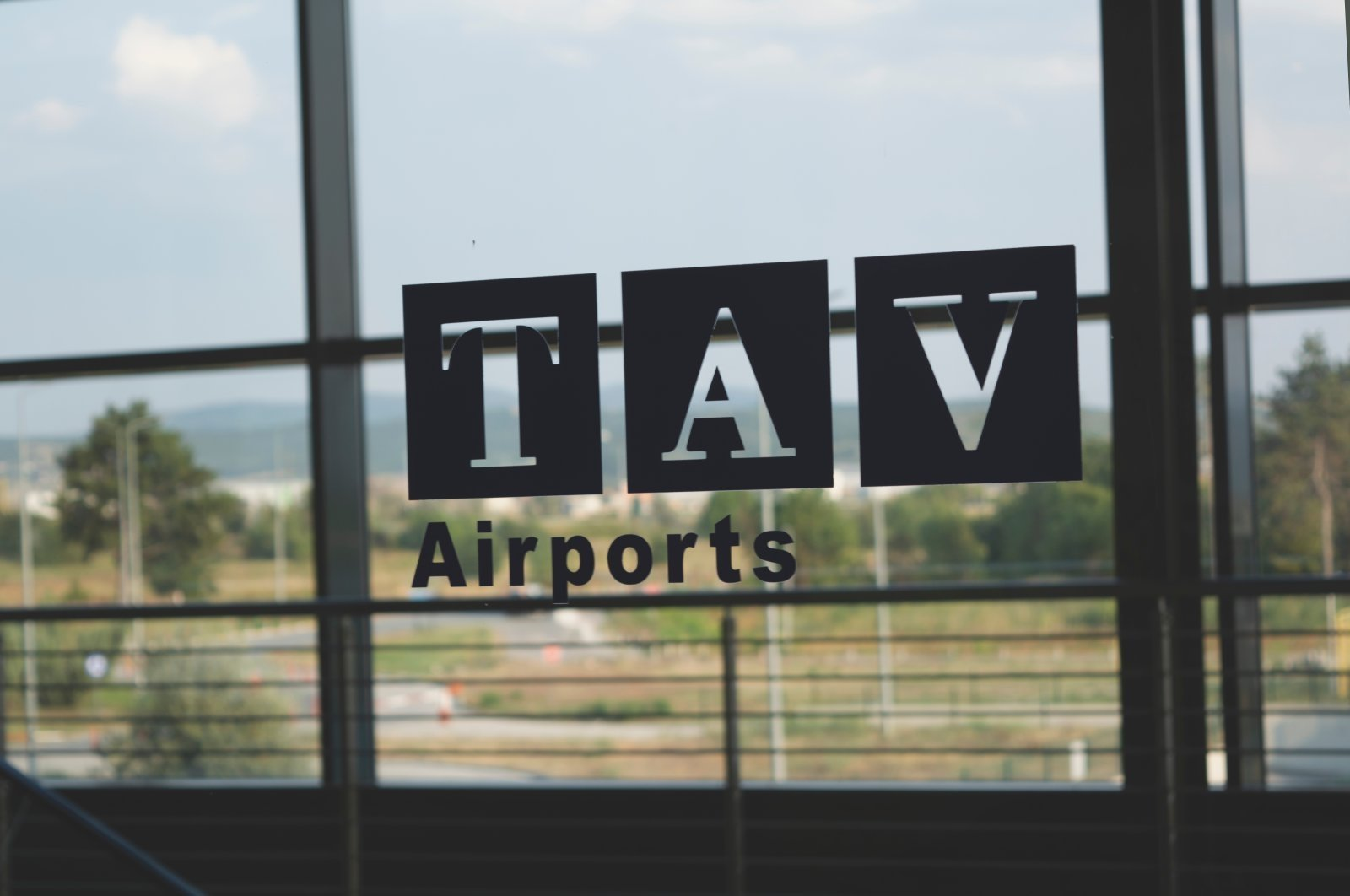 TAV Airports' logo is seen on an airport window in Skopje, Macedonia, Aug. 10, 2019. (Shutterstock Photo)
