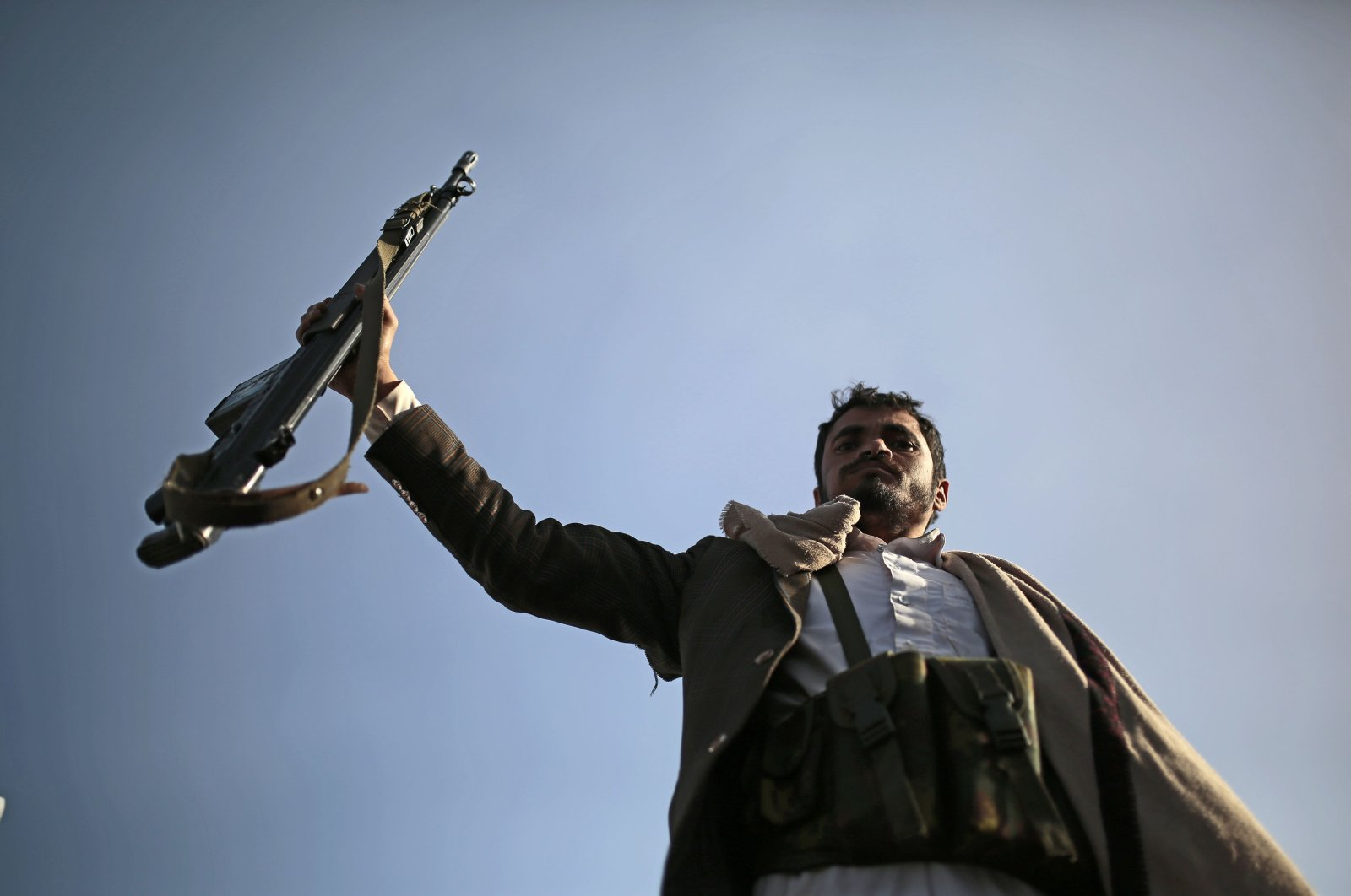A Houthi supporter holds his weapon during a demonstration against the United States over its decision to designate the Houthis a foreign terrorist organization in Sanaa, Yemen, Jan. 25, 2021. (AP Photo)