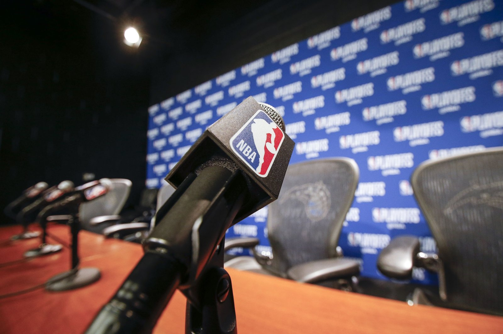 A general view of a microphone with the NBA logo at the post press conference after an NBA game at the Amway Center in Orlando, Florida, U.S., April 19, 2019. (Getty Images)