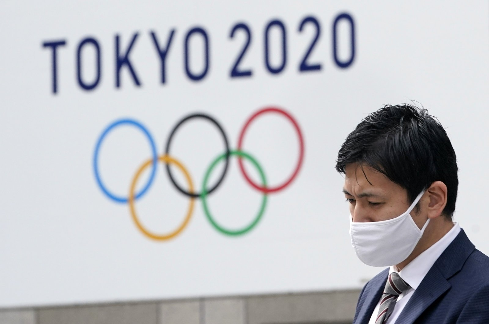 A man walks past a Tokyo Olympic Games advertising board outside the Tokyo Metropolitan Government Office in Tokyo, Japan, Jan. 27, 2021. (EPA Photo)