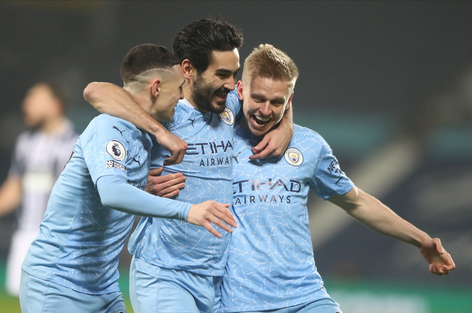 Manchester City's Ilkay Gündoğan (C) celebrates with teammates Oleksandr Zinchenko (R) and Phil Foden (L) after scoring a goal in a Premier League match against West Bromwich Albion, West Bromwich, England, Jan. 26, 2021. (EPA Photo)