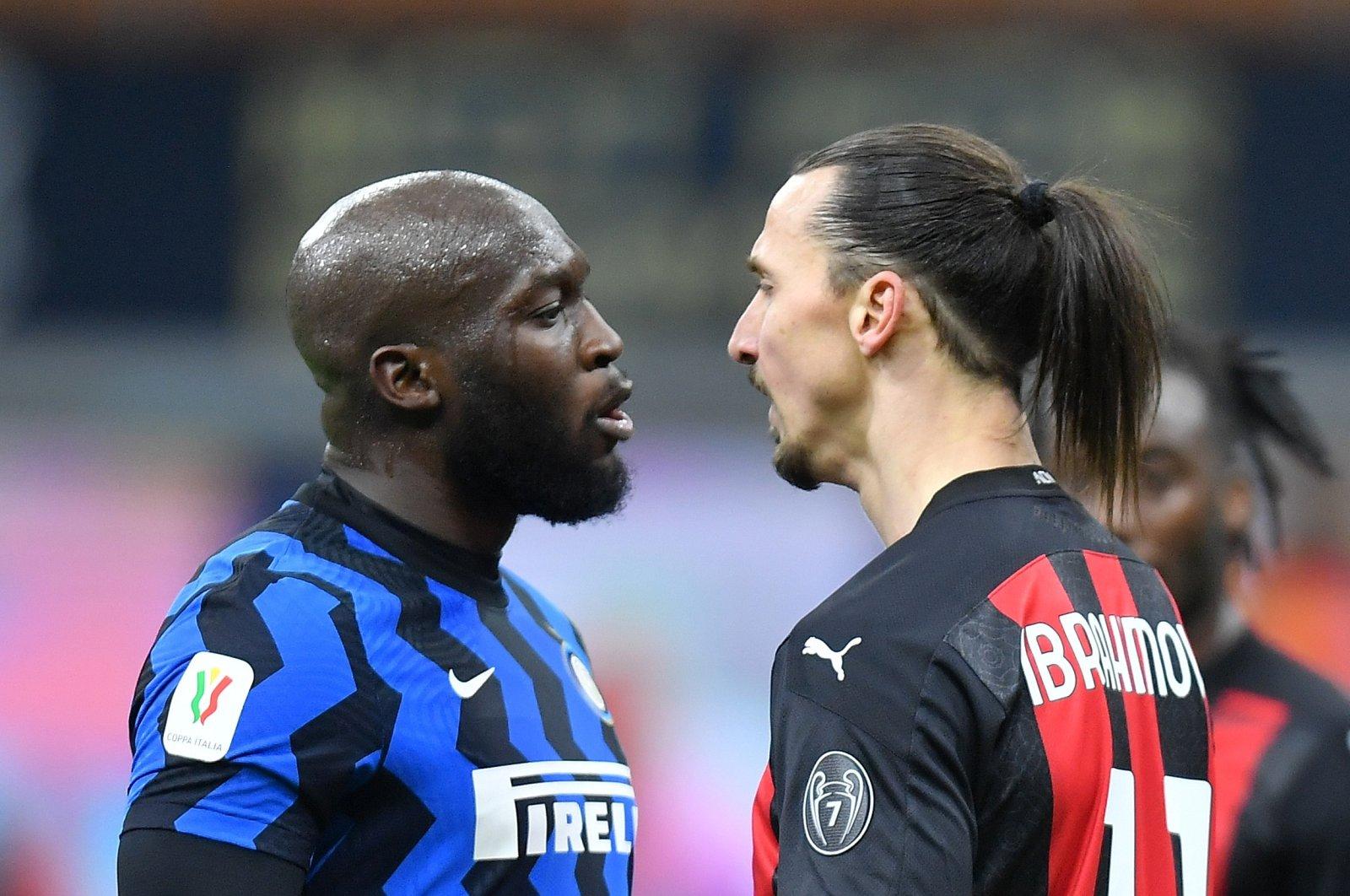 AC Milan's Zlatan Ibrahimovic (R) and Inter Milan's Romelu Lukaku argue during an Italian Cup quarterfinal football match between Inter Milan and AC Milan at the San Siro stadium, in Milan, Italy, Jan. 26, 2021. (Reuters Photo)
