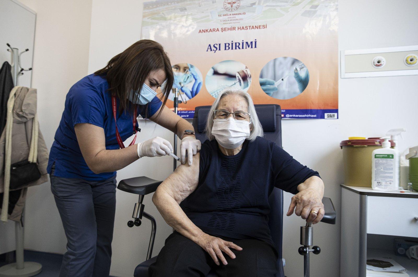 An elderly woman gets vaccinated at a hospital, in the capital Ankara, Turkey, Jan. 27, 2021. (AA PHOTO)