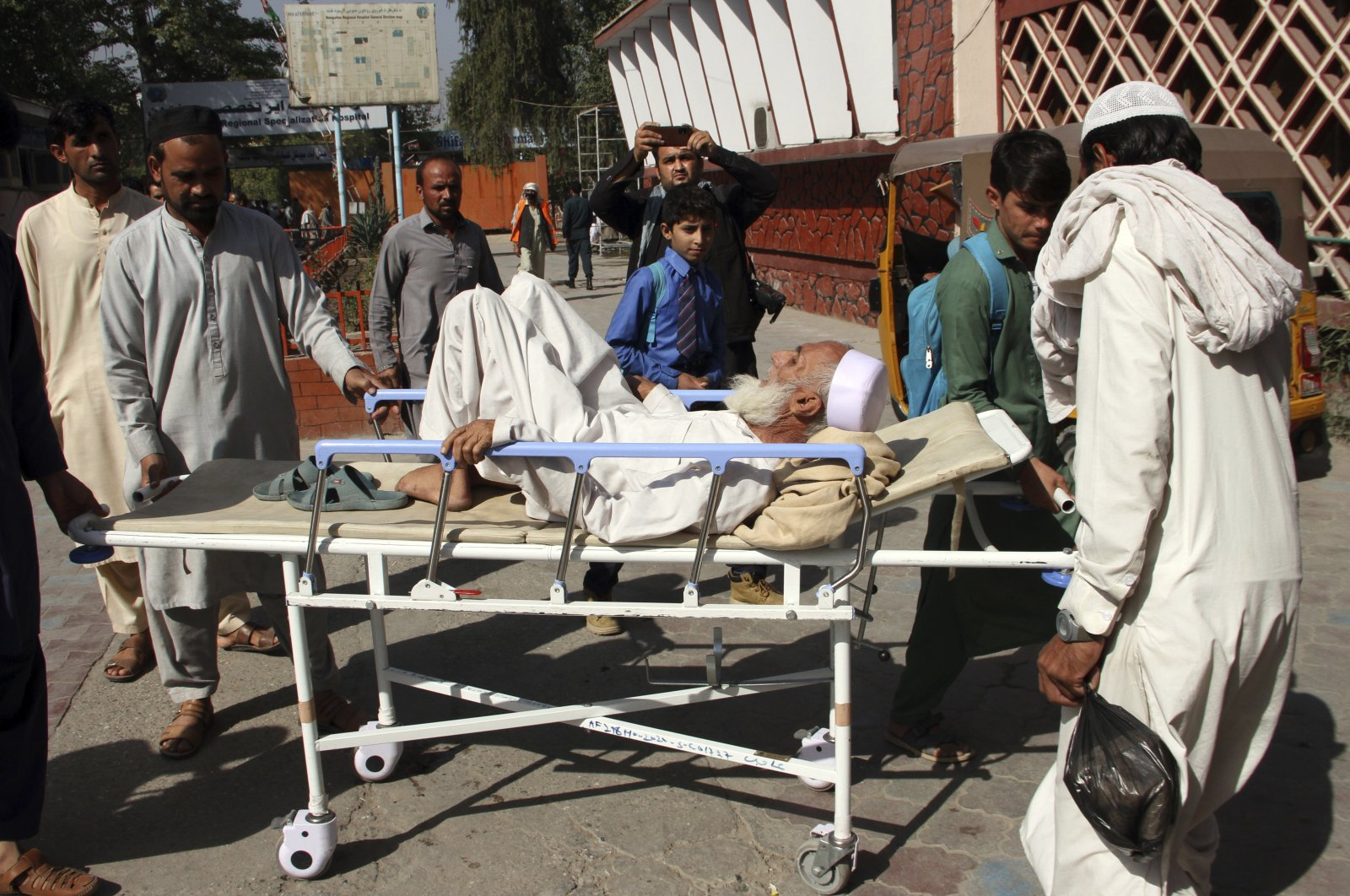 A man injured in a stampede is brought to a hospital in the city of Jalalabad east of Kabul, Afghanistan, Oct. 21, 2020. (AP Photo)