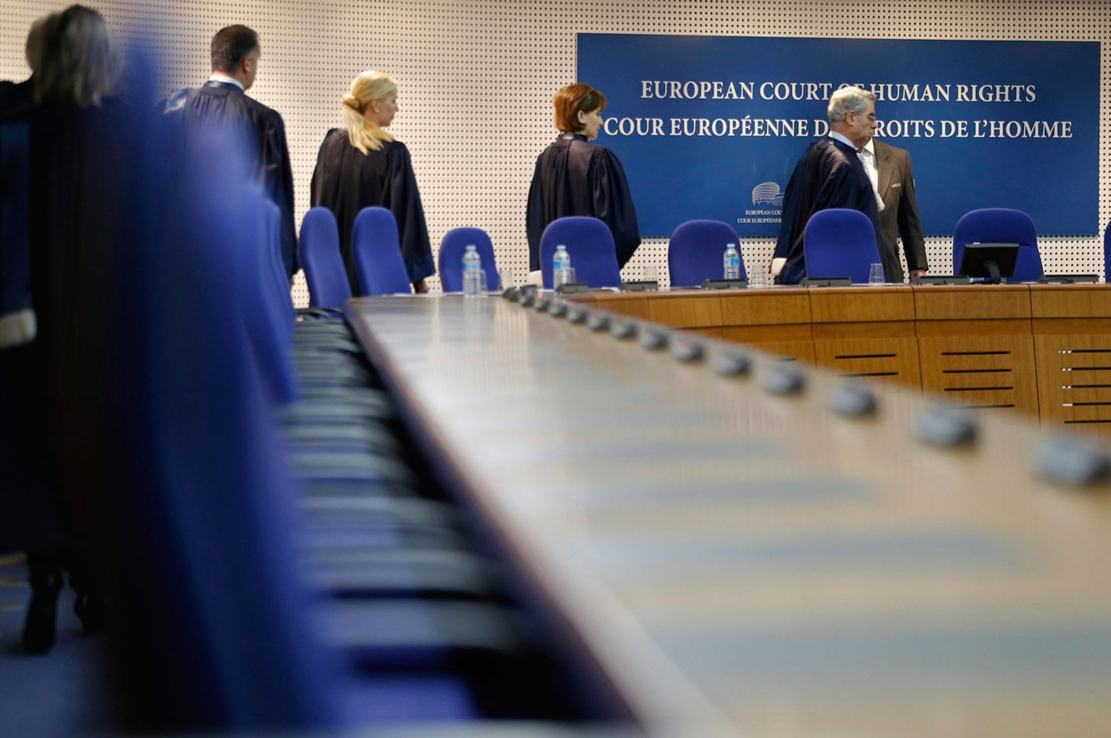 Judges of the European Court of Human Rights enter the hearing room of the court in Strasbourg, France, Dec. 3, 2013.
