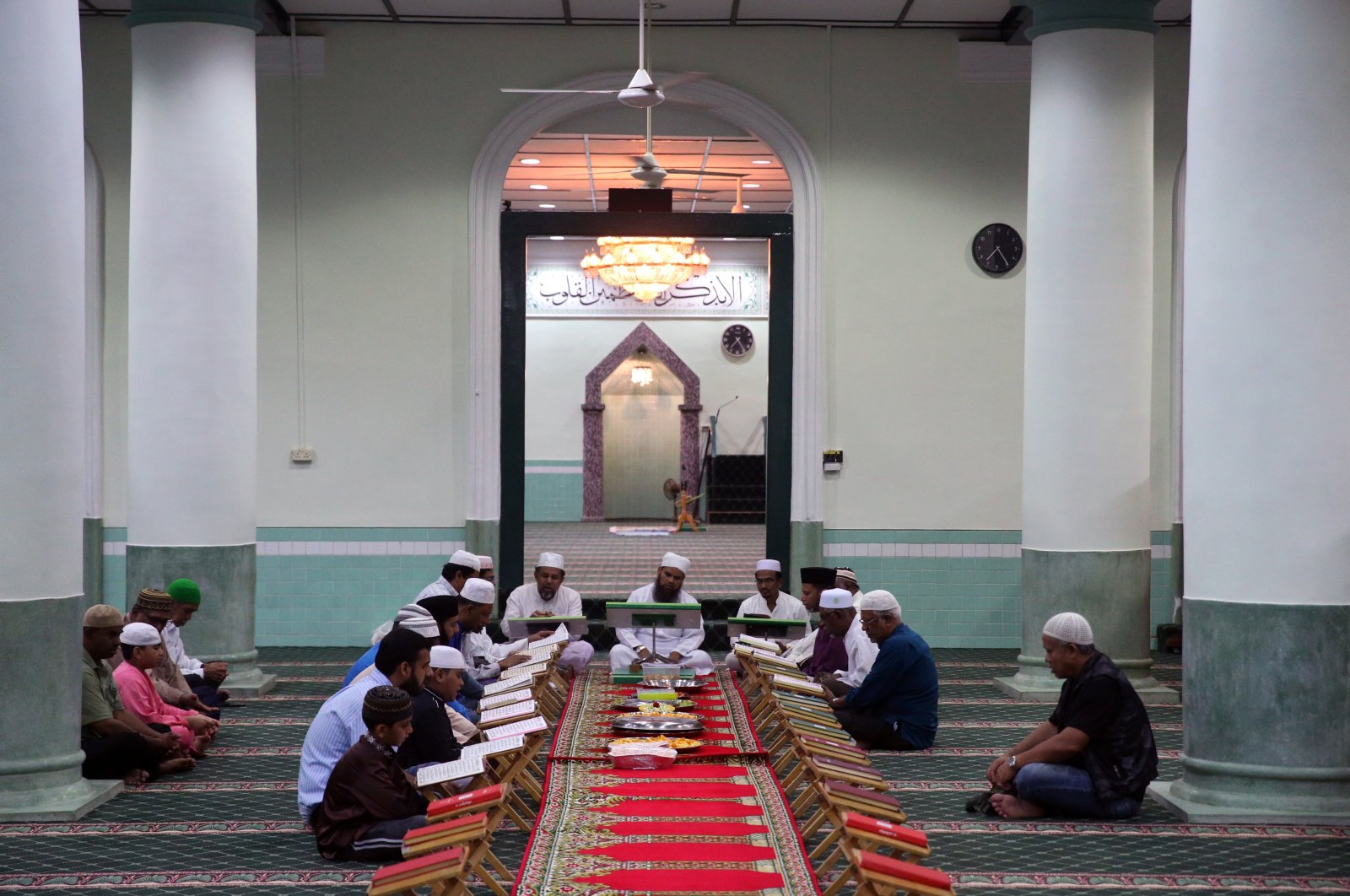 Muslims studying the Quran in Masjid Jamae, one of the earliest mosques in Singapore located in Chinatown, Feb. 25, 2017. (Shutterstock Photo)