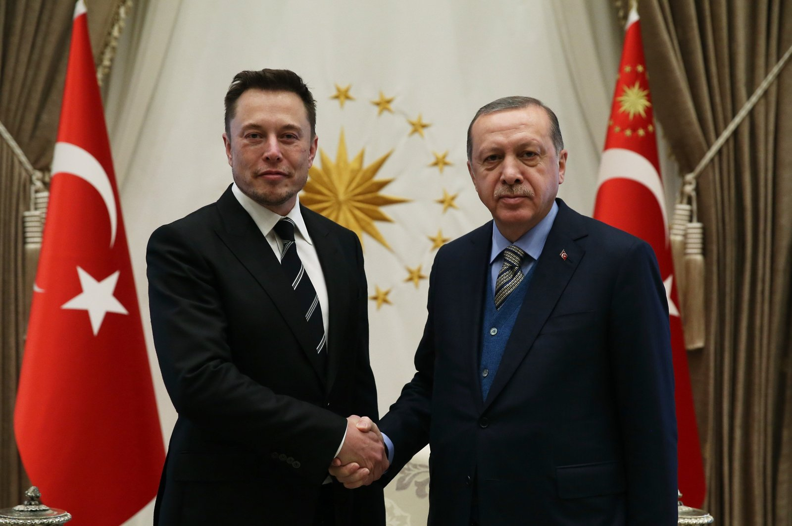 Tesla and SpaceX CEO Elon Musk (L) shakes hands with Turkish President Recep Tayyip Erdoğan during a visit, in Ankara, Turkey, Nov. 8, 2017. (IHA Photo)
