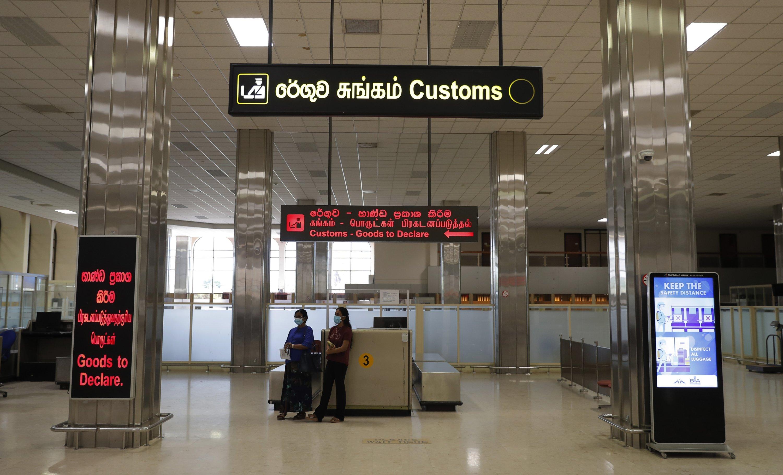 Sri Lankan passengers wait at the customs desk upon their arrival at Katunayake International Airport in Colombo, Sri Lanka, Jan. 20, 2021. (AP Photo)