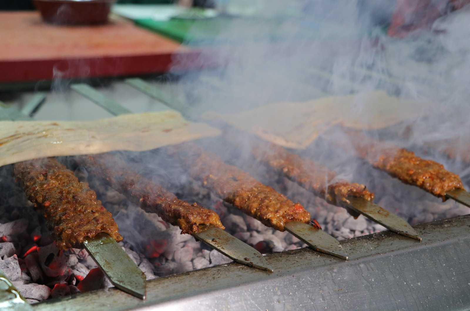 Traditional Adana kebab is grilled on iron skewers over an open mangal, a traditional Turkish barbecue, in Adana, southern Turkey, Jan. 14, 2021. (IHA Photo)